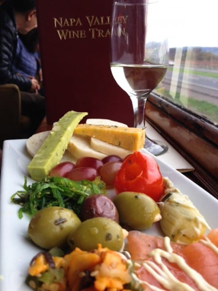We enjoyed a glass of wine and a plate of cheese, fruit, olives, smoked salmon,calamari and seaweed salad.