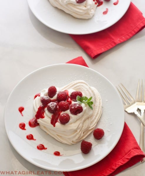 Meringue hearts with raspberries and whipped cream. @whatagirleats