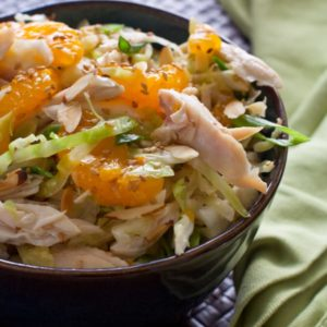 Chinese Chicken Salad, crisp cabbage, shredded chicken in a slightly sweet dressing with sliced almonds and mandarin oranges.@whatagirleats.com