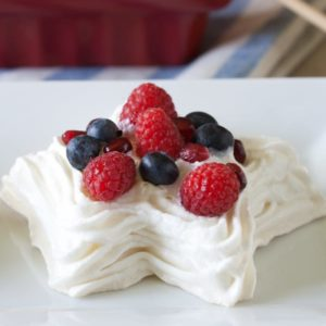 Star-shaped meringues filled with berries and fresh whipped cream.