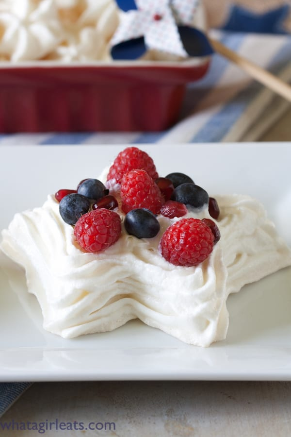 "Star meringues, ""spangled"" with a dazzling display of bright, fresh berries. Star spangled meringues are a patriotic holiday dessert that will impress your guests! - Recipe on WhatAGirlWants.com"