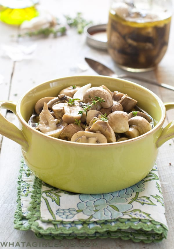 Simple marinated mushrooms are just that - Mushrooms marinated in white wine, vinegar, herbs and garlic. Perfect on a steak!