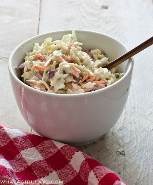 Creamy cole slaw is a side dish that appears at every potluck dinner and outdoor picnic. Because this cole slaw recipe has a creamy dressing with no refined sugar, it'll become your favorite! | WhatAGirlEats.com