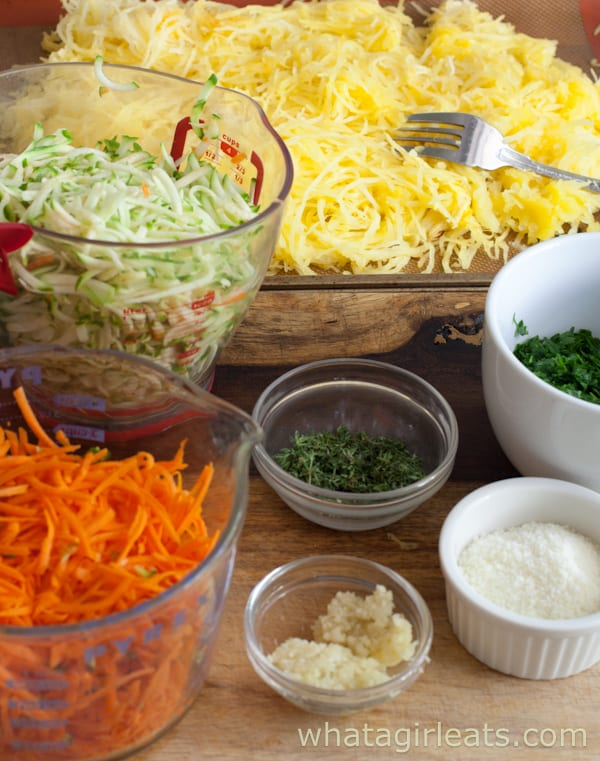 Assembling a harvest squash casserole with shredded spaghetti squash, carrots, and zucchini.
