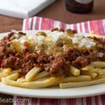 Sloppy Joe Cheese Fries; make the Sloppy Joe meat in the slow-cooker, top with cheese and onions. Game day favorite.