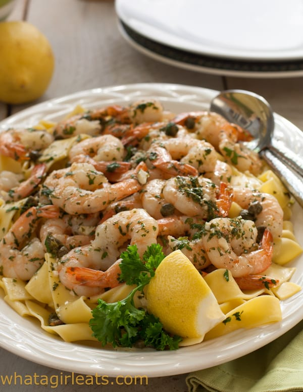 Get dinner on the table quickly with this easy 30-minute Shrimp Picatta. Get the recipe on WhatAGirlEats.com