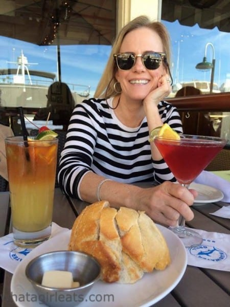 Enjoying a pomegranate martini while overlooking the waterfront at Bluewater Grill, in Newport Beach, CA.