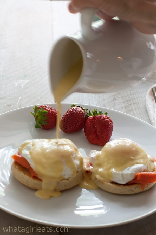 Hollandaise being poured over Eggs Royale