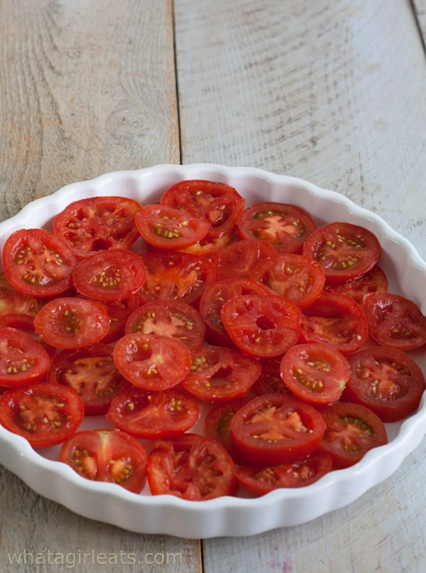 Gluten-free Tomato Cheese Tart with Fresh Thyme. Layer the tomatoes in a tart pan.