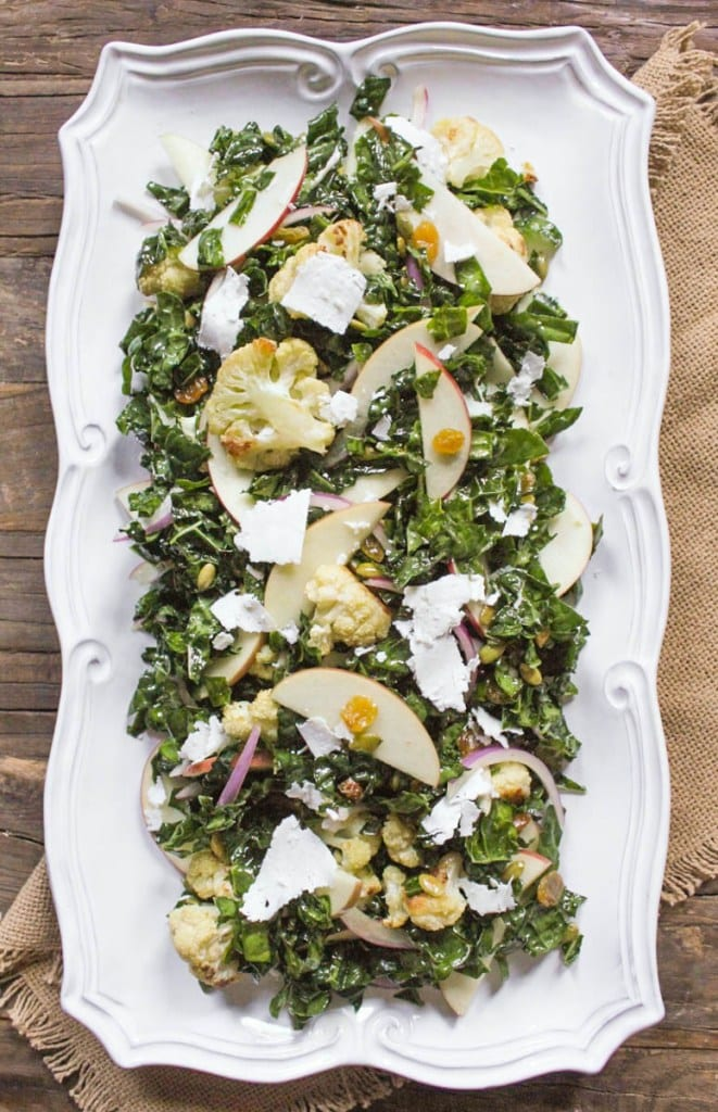 Healthy side dishes.Autumn Kale Salad with Roasted Cauliflower and Apple. Photo credit: Domesticate Me.