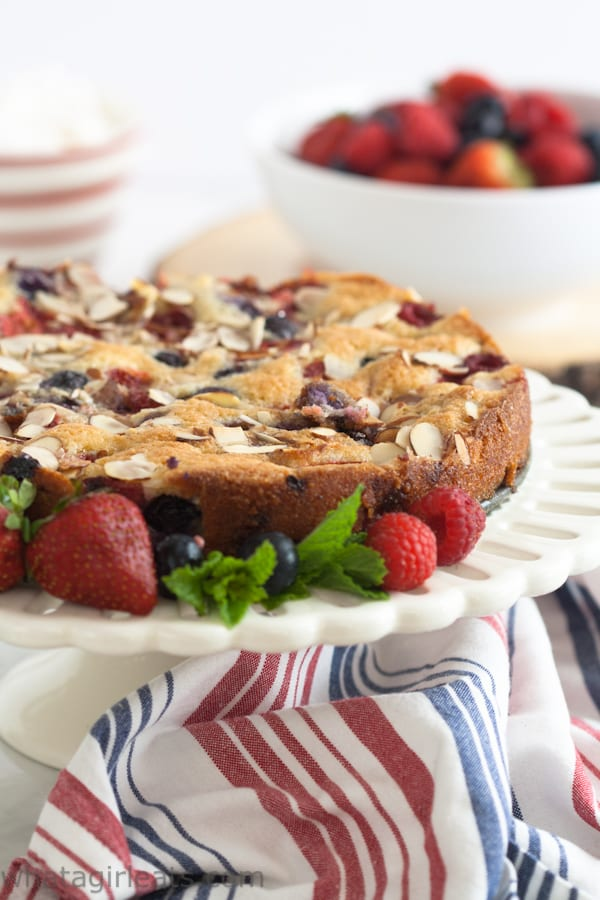 Fresh Berry cake on a white cake stand