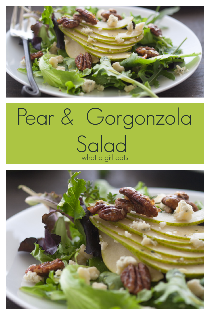 Pear and gorgonzola salad with candied pecans on a bed of field greens.