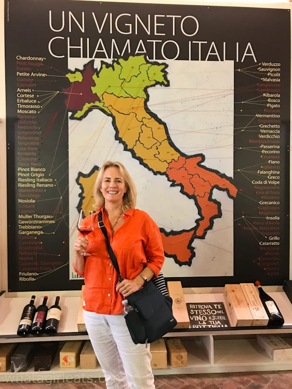 what a girl eats in front of wine map of italy